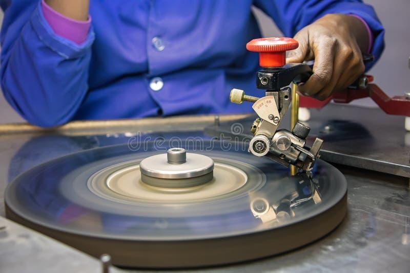 Diamonds polishing factory. Machines to polish diamonds, grading diamonds, african woman working. In Africa , Botswana stock photos