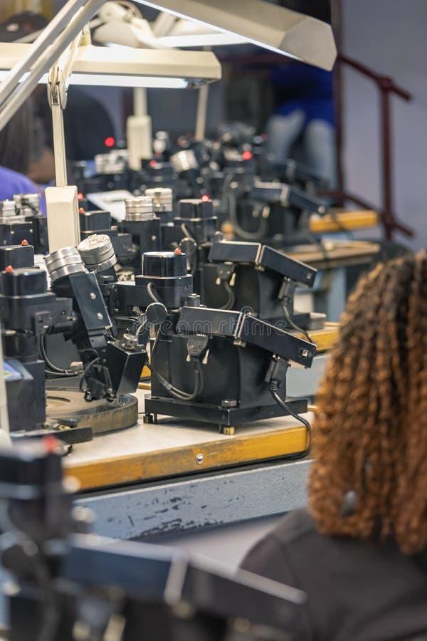 Diamonds polishing factory. Machines to polish diamonds, grading diamonds, african woman working. In Africa , Botswana royalty free stock image