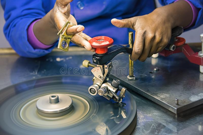Diamonds polishing factory with worker. Machines to polish diamonds, grading diamonds, african woman working. In Africa , Botswana royalty free stock photos