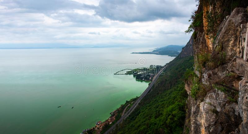 Dian Lake from the Xishan mountain in Kunming, China. Road above Dian Lake from the Xishan mountain in Kunming, China, dianchi, dragon, gate, skyline, transport stock photography