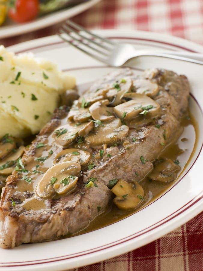 diane mosar steak för potatissåsländstycket arkivfoto