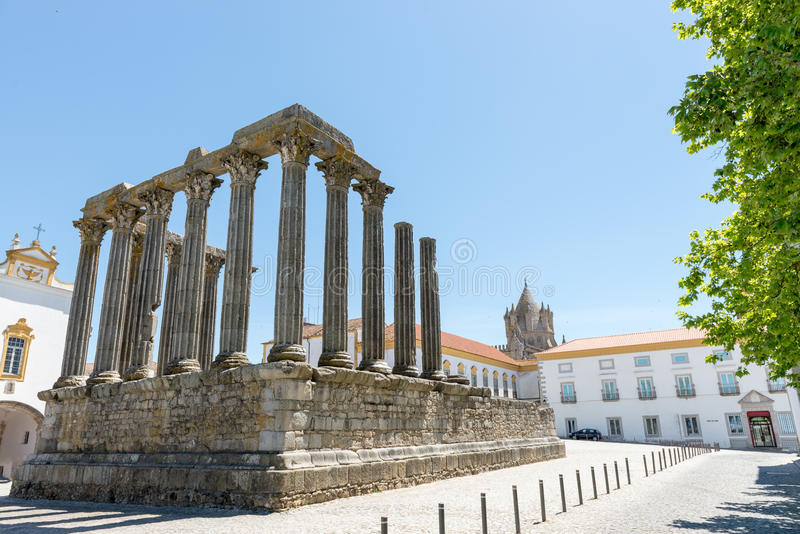 Dianna Temple and cathedral tower in Evora. Ancient roman temple stock image