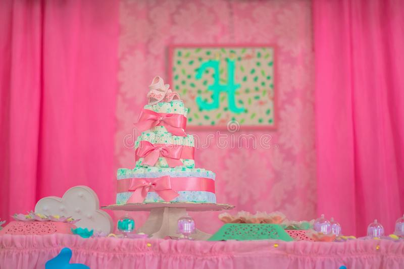 Diaper cake, baby tea with diapers decorated table stock photography