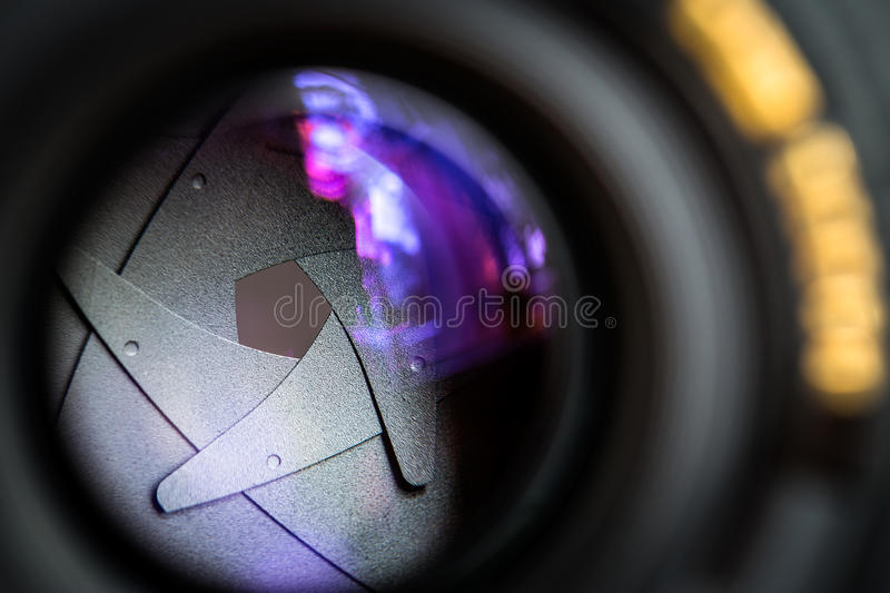 Diaphragm of a camera lens aperture. royalty free stock photography