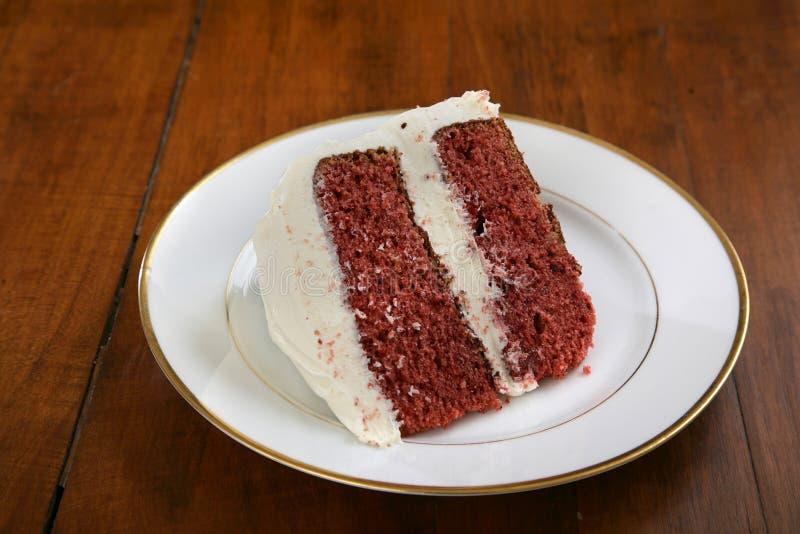 Diapositiva de la torta roja del terciopelo fotos de archivo