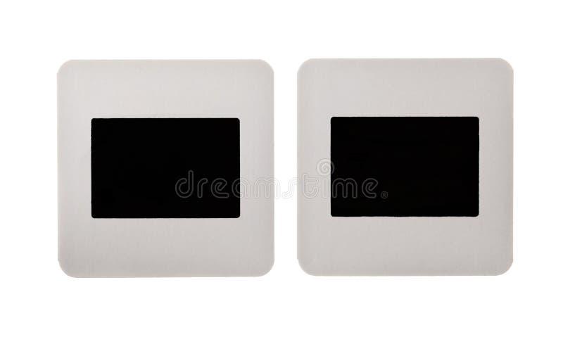 Diapositivas del papel de la vendimia aisladas en blanco imagen de archivo