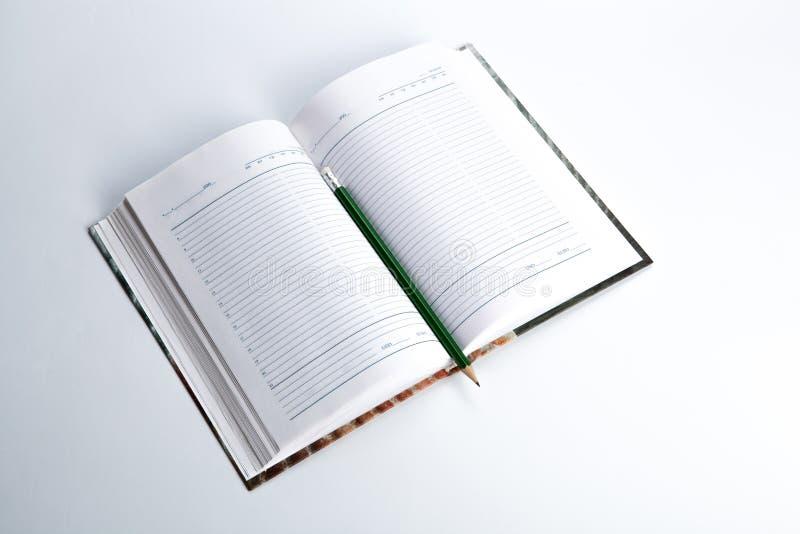 Diario con el lápiz fotos de archivo