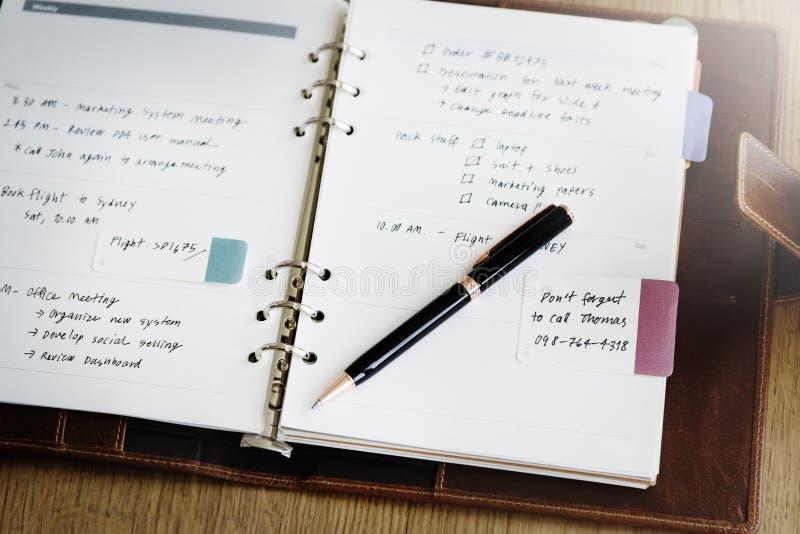 Diario de la nota del horario para hacer concepto de la lista imagen de archivo