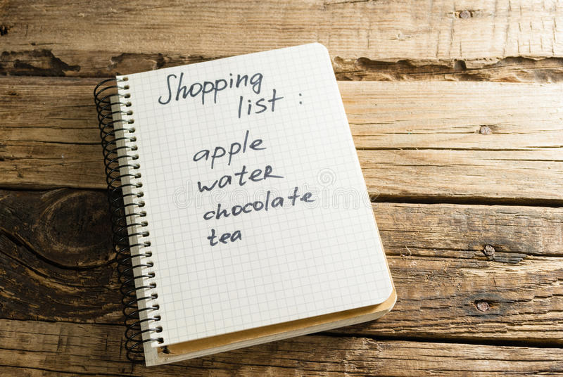 diario notepads Una nota Lista di acquisto fotografia stock libera da diritti