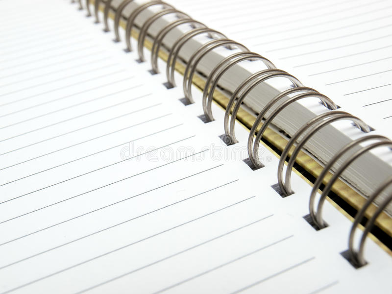 Diary. Open blank sheet of a diary with metal spiral binding royalty free stock photography