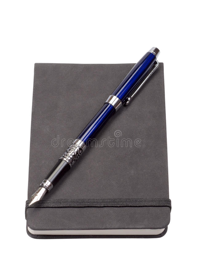 The diary with a blue fountain pen. Isolated on a white background stock photos