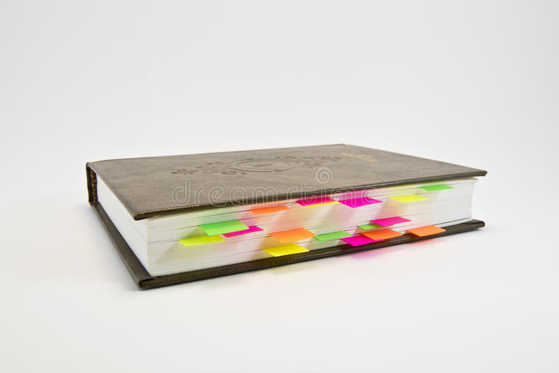 Diary with colored tabs stock photography