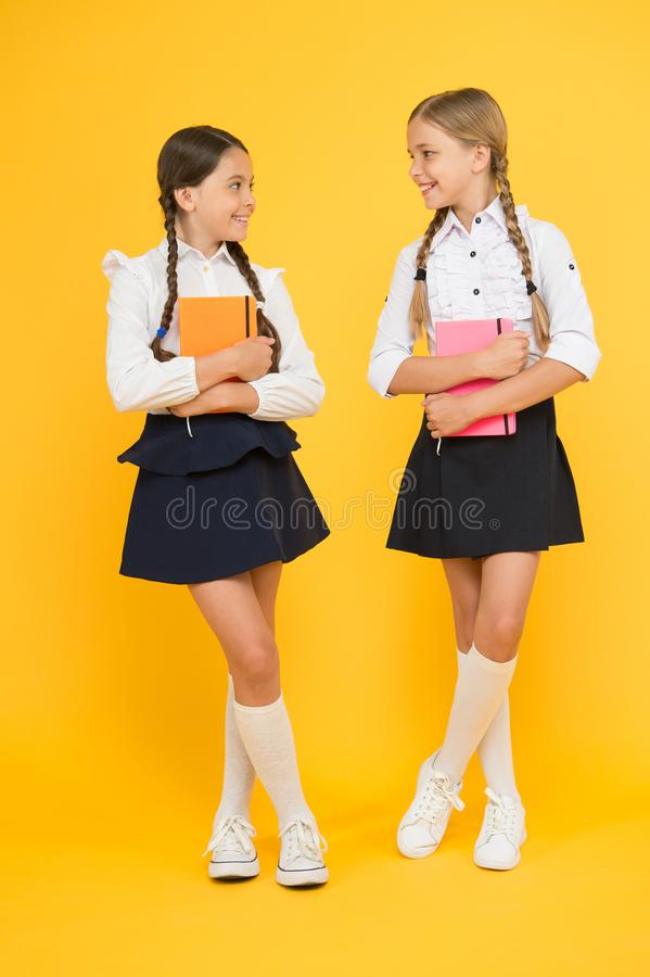 Diary for girls concept. back to school. Classmates at book store or library. small girls kids with book. literature. Lesson. childrens literature. reading and stock photo