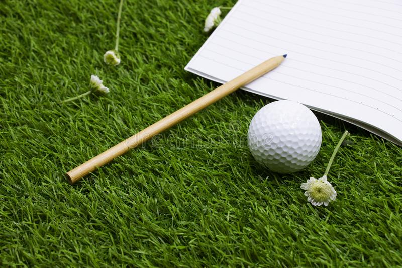 Diary of golfer with golf ball is on green grass stock photos