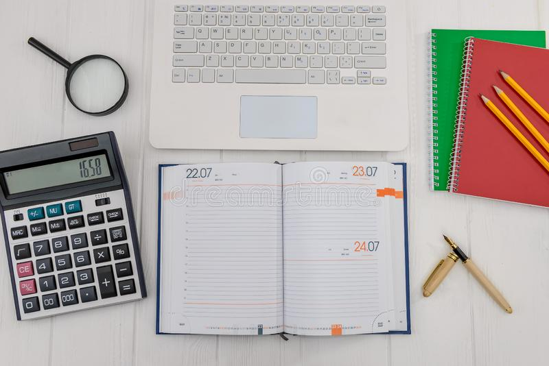 Diary with laptop on desk, workplace concept.  stock photo