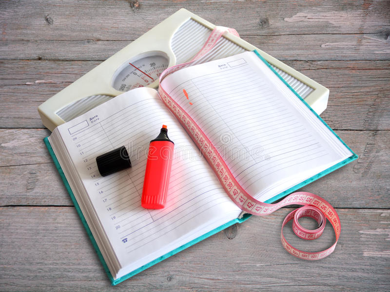 Diary losing weight women royalty free stock photography