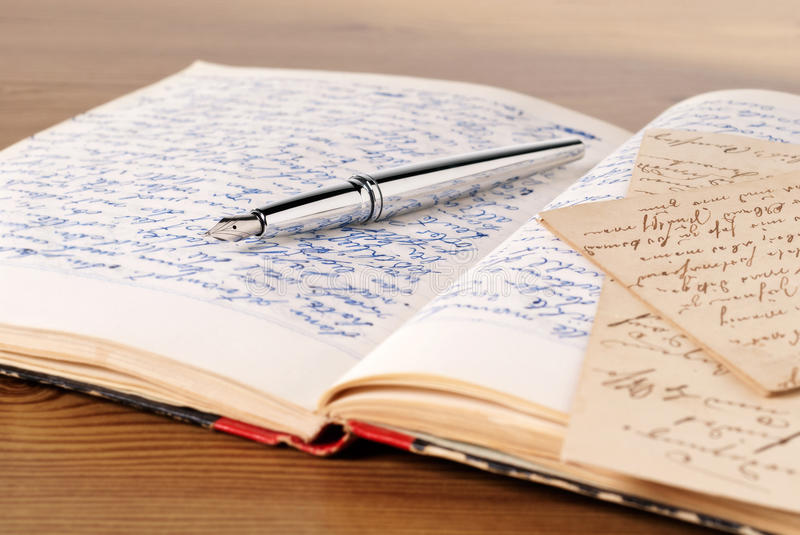 Diary. An opened Diary, pen and a letter stock photography