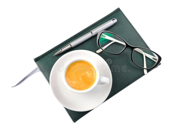 Diary, pen, cup of coffee and glasses royalty free stock photography