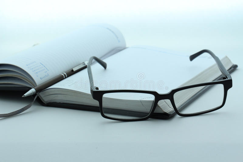 Diary, pen and glasses royalty free stock photos