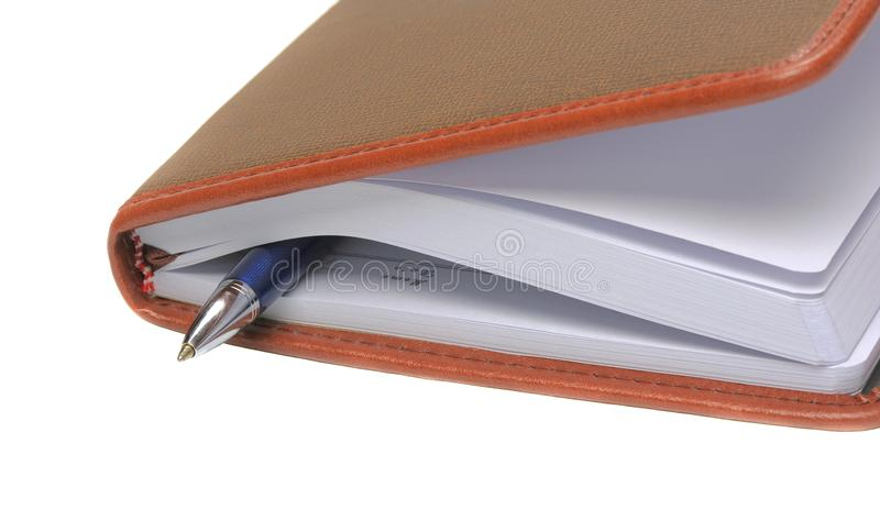 Diary with a pen between pages stock photos