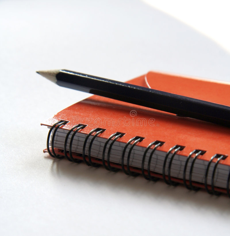 Diary and pencil stock photos