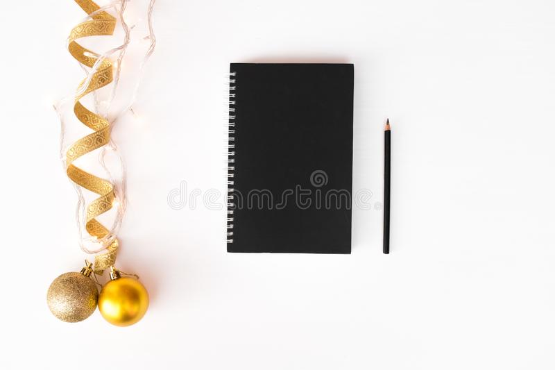 Diary post card flyer Christmas composition background. wallpaper, ribbon, lights and decoration balls, on white background. royalty free stock photo