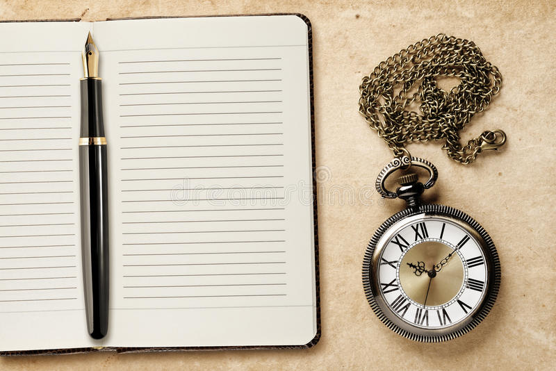 Diary and vintage pocket watch royalty free stock images