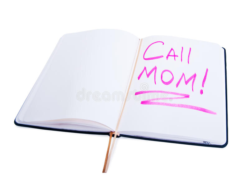 Diary with the words call mom. Open diary with the words call mom royalty free stock photos