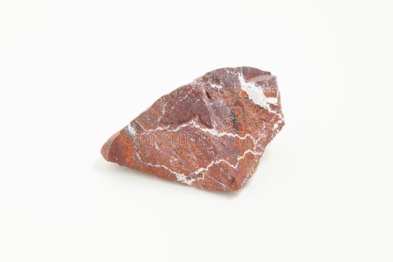 Diaspro del minerale metallifero su fondo bianco immagini stock