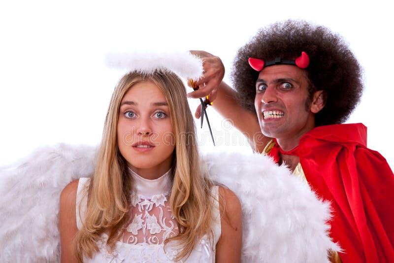 Diavolo ed angelo fotografia stock libera da diritti