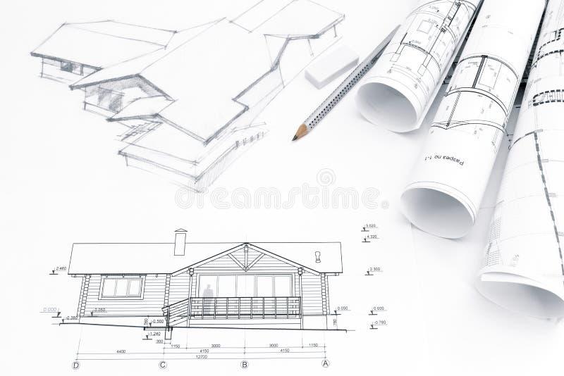 Dibujo arquitectónico con los modelos y los rollos fotografía de archivo libre de regalías