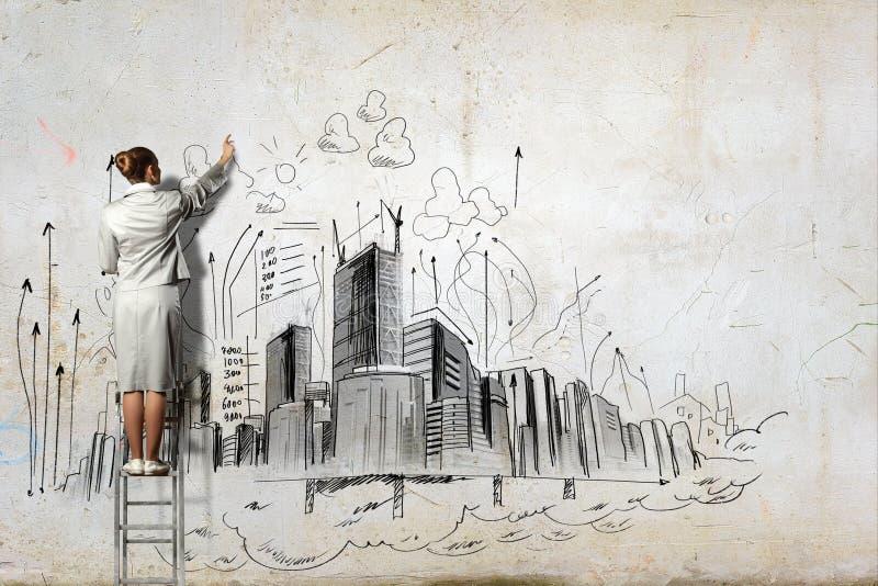 Dibujo de la empresaria en la pared imagen de archivo