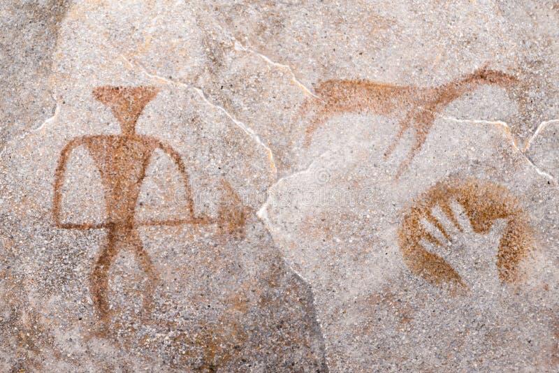 Dibujo de un hombre antiguo, animales en una pared de la cueva ilustración del vector