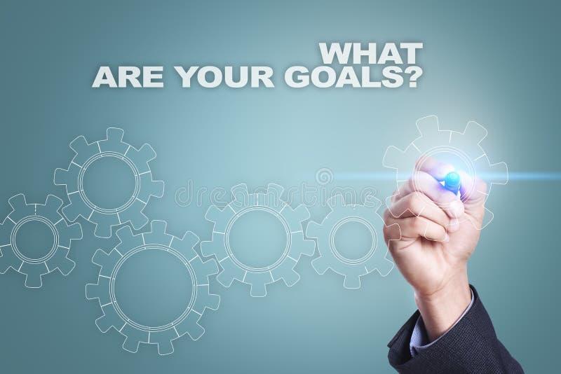 Dibujo del hombre de negocios en la pantalla virtual Cuáles son su concepto de las metas fotos de archivo