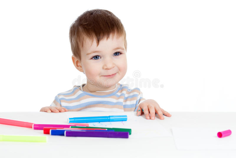 Dibujo del niño en la tabla aislada fotos de archivo