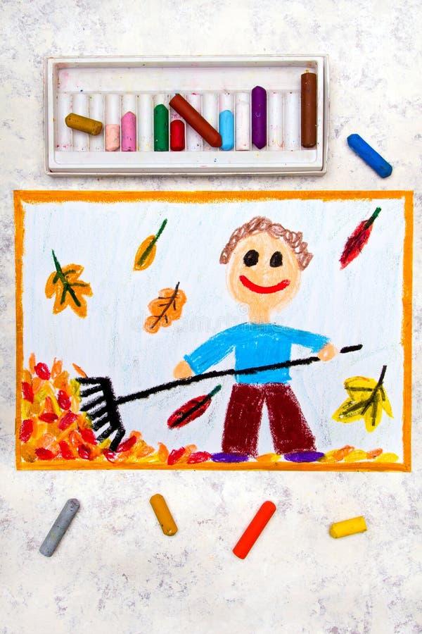 dibujo: Un muchacho sonriente está rastrillando las hojas imágenes de archivo libres de regalías