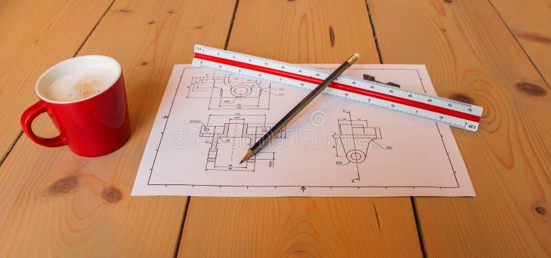 Dibujo y café técnicos fotografía de archivo libre de regalías