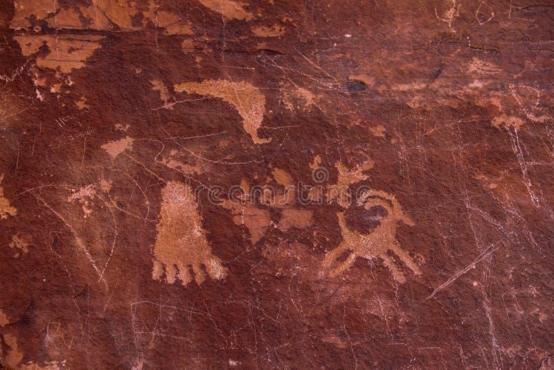 Dibujos de piedra indios antiguos foto de archivo libre de regalías