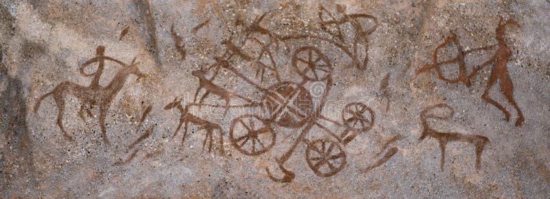 Dibujos de un hombre antiguo en la pared de la cueva ocre stock de ilustración