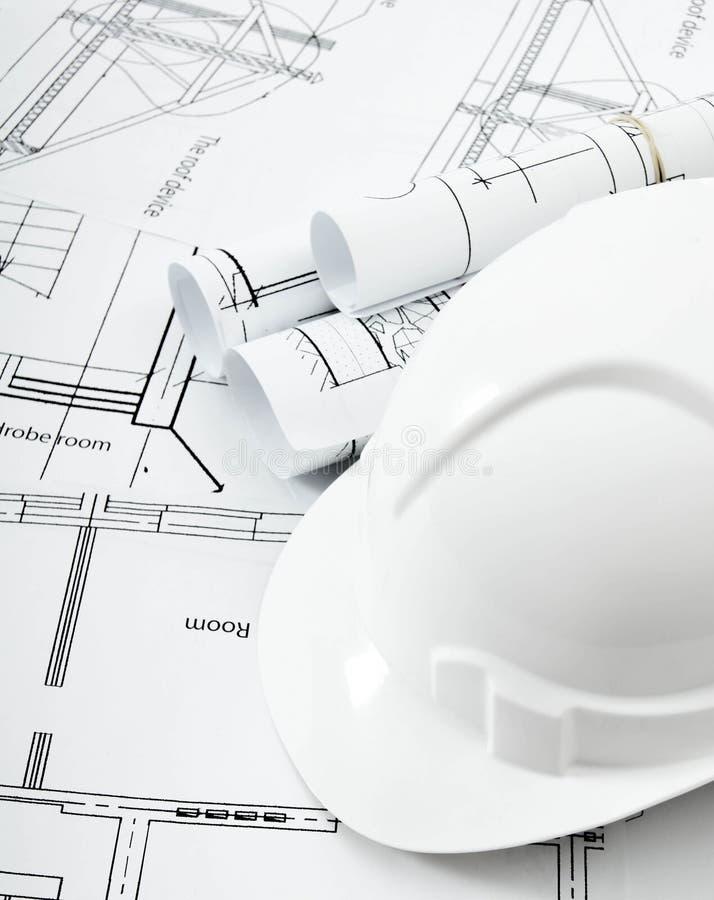 Dibujos para la casa y el casco constructivos Trabajo fotografía de archivo libre de regalías