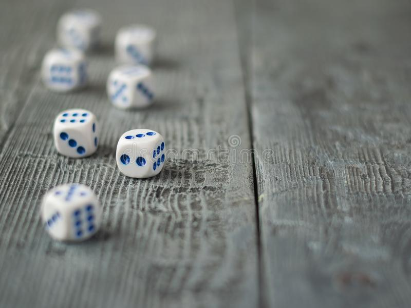 Dice blue and white color on wooden rustic table. royalty free stock photos