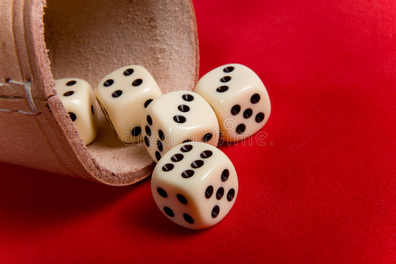 Dice cup and dice. On background stock photography