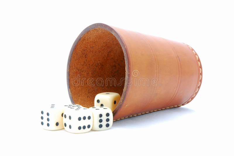 Dice cup with dices. An old used leather dice cup with five dotted dices. Image isolated on white studio background stock photos