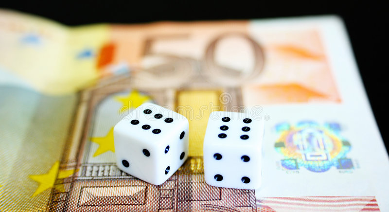 Dice and Currency. A pair of dices and money stock photography