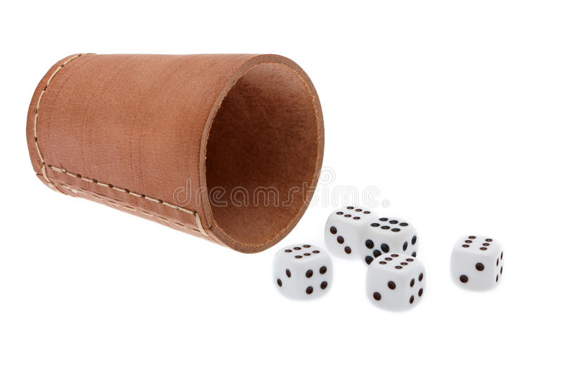 Dice with dice cup stock photography