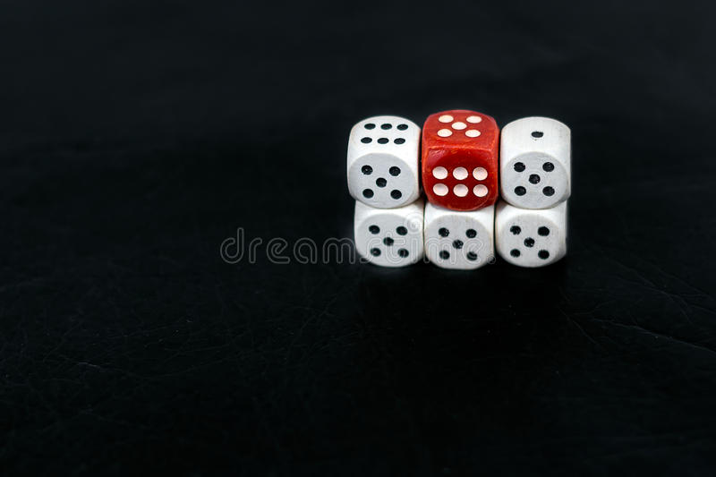 Dice five fives and red six on a black background royalty free stock image
