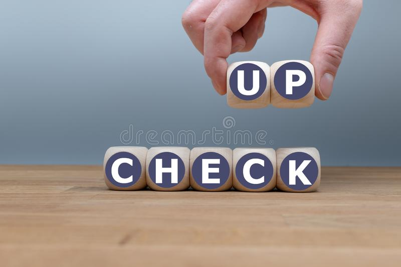 Dice form the word `check up` royalty free stock photo