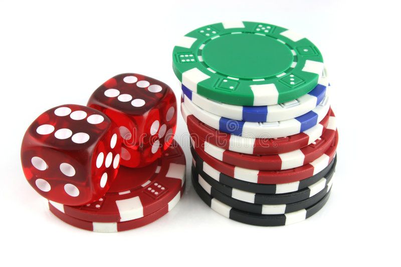 Dice and Gambling Chips. 2 Dice close up with gambling chips royalty free stock photo