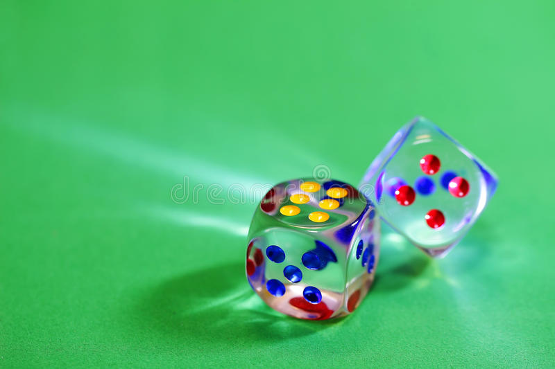 Gambling. Dice. Games of chance. Green background royalty free stock images