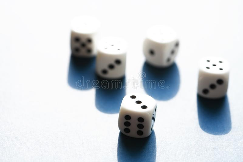 Dice Game On Blue. Few dice cubes on blue background with free space stock image